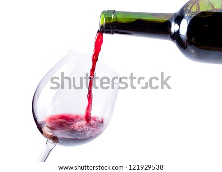 red wine pouring in the glass isolated over white background