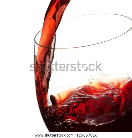 Red wine pouring into a wineglass - stock photo