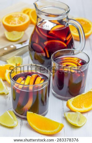 Red wine sangria with oranges and lemons - stock photo