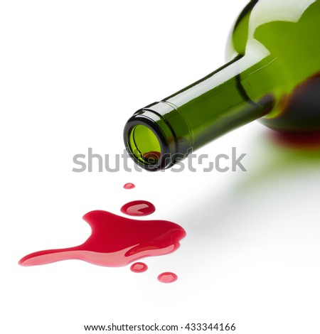 red wine spilling from the bottle - stock photo