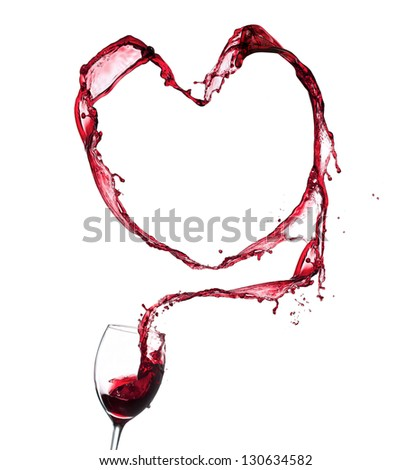 Red wine splashing from glass in heart shape, isolated on white background - stock photo