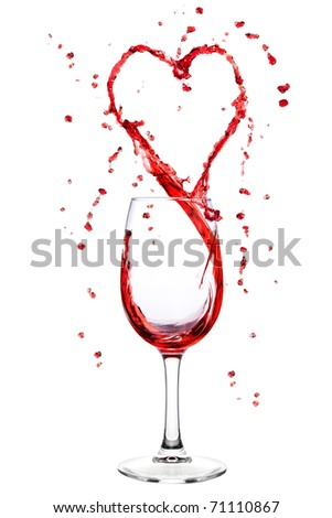 Red wine splashing from wineglass in heart shape - stock photo