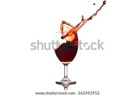 red wine splashing on white background - stock photo
