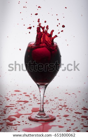 Red wine splashing out from a glass