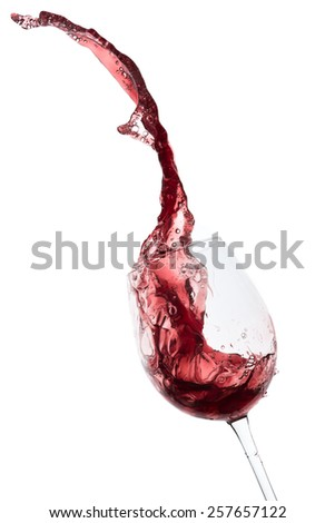 red wine splashing out of a glass, isolated on white - stock photo
