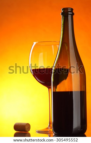 Red wine - still-life with glass, bottle and cork - stock photo