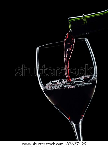Red wine Wine Pour on black background, backlight - stock photo