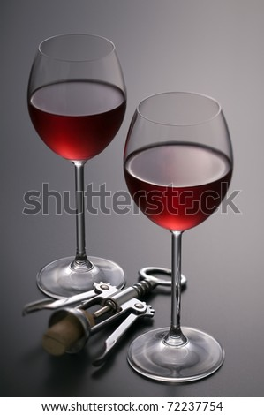 Red wine with corkscrew close up shoot