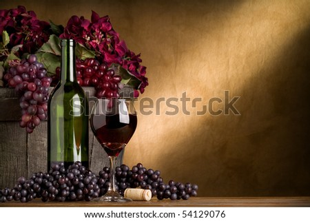 Red wine with grapes and barrel - stock photo