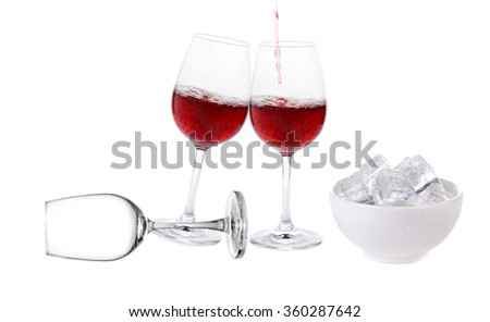 Red wine with ice cube in the cup on white background - stock photo