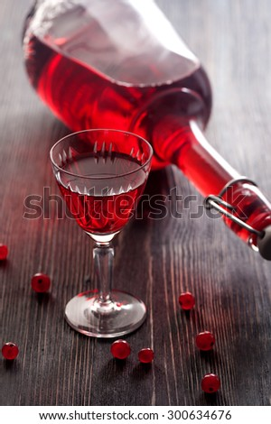 Red wine with red currant berries