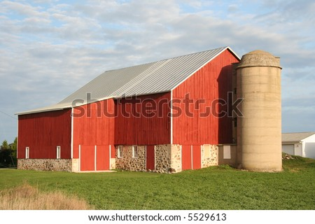 red Wisconsin dairy barn with cement silo - stock photo