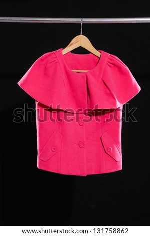 Red woman clothes on a hanger isolated - stock photo