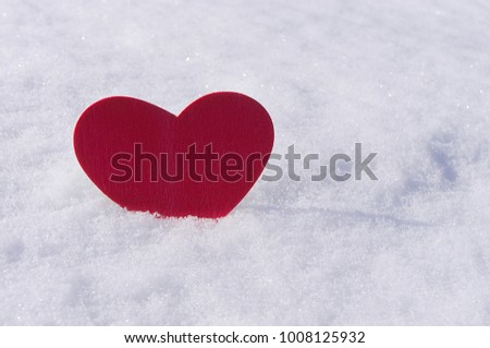 Red wood heart in snow