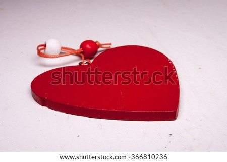 red wooden heart decoration