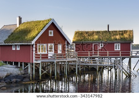 Red wooden house called rorbu at the Lofoten archipelago, Norway - stock photo