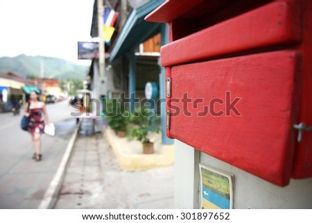Red wooden mail box  - stock photo