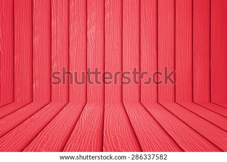 Red wooden wall and wooden floor background. - stock photo