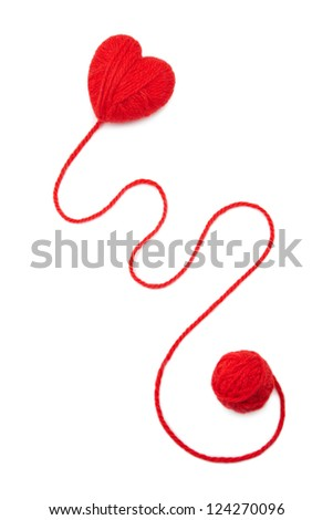 Red wool hearts on white background - stock photo