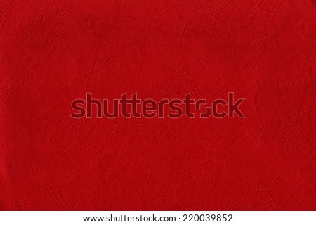 Red wrinkled paper texture. - stock photo