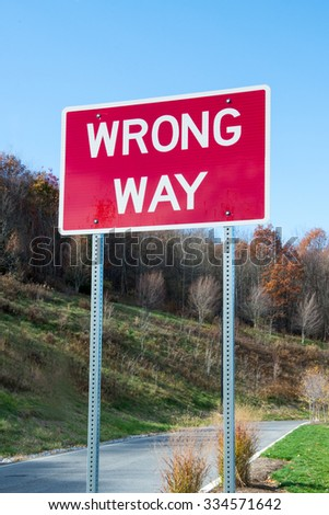 Red wrong way sign - stock photo