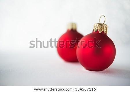 Red xmas ornaments on glitter holiday background. Winter holidays. Xmas theme. Copy space. Happy New Year.