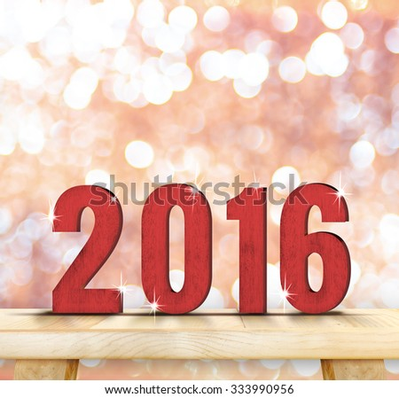 Red 2016 year wood number on wooden table top with sparkling pink bokeh,Holiday mock up , leave space for adding text - stock photo