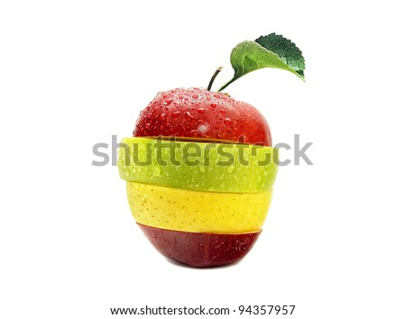 Red, yellow and green sliced apple with moisture - stock photo