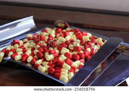 Red yellow capsules on the drug count tray