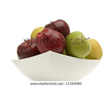 Red, yellow, green apples in a vase over white - stock photo