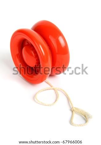 Red yo yo isolated on white background - stock photo