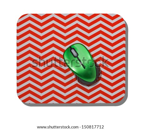 Red zig zag Mouse Mat with Green Mouse. - stock photo