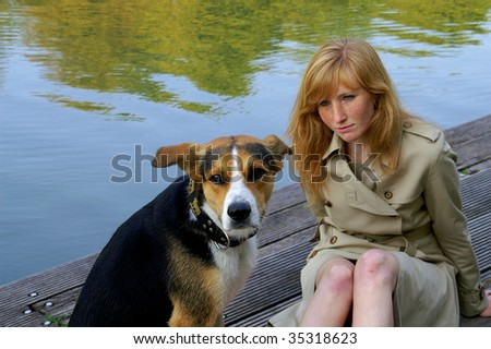 Redhair girl and her dog