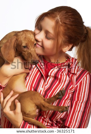 redhair girl  holding a dog - stock photo