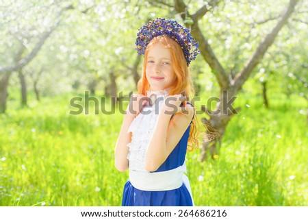 redhair girl in a sunny garden - stock photo