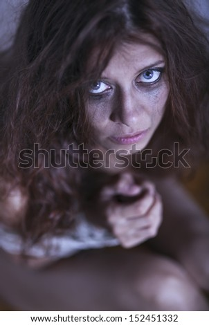 redhaired woman bondage on gray background - stock photo