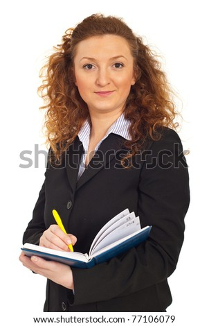 Redhead business woman writing in personal agenda isolated on white background