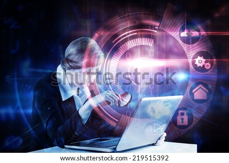 Redhead businesswoman using her laptop against pink technology dial interface design