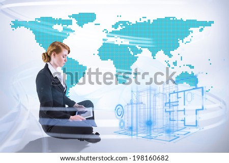 Redhead businesswoman using her tablet pc against green world map on white background - stock photo