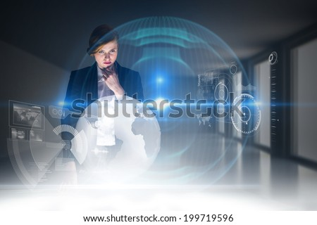 Redhead businesswoman using interactive desk against digitally generated room with windows - stock photo