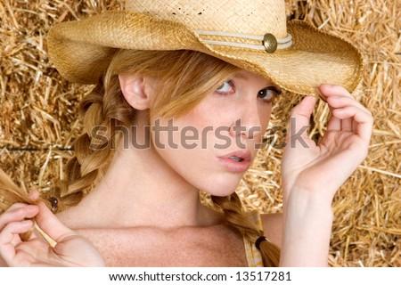 Redhead Cowgirl - stock photo