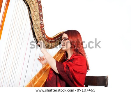 Redhead Girl and Wooden Harp isolated on white