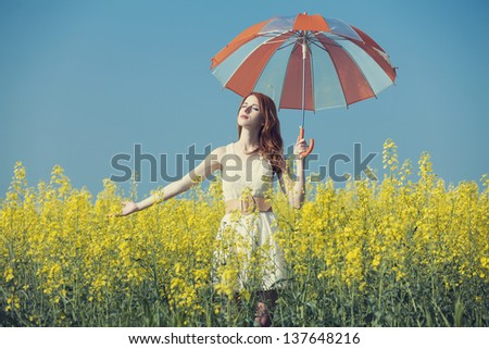 Redhead girl at field