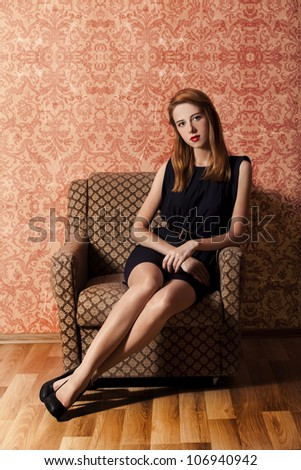 Redhead girl in armchair. 60s - stock photo