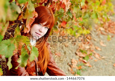 redhead girl in the fall time - stock photo