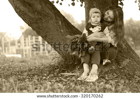 redhead girl with son Autumn leaves