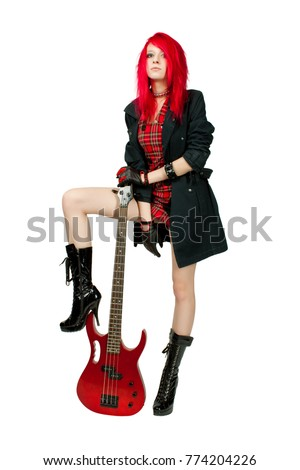 Redhead rocker girl posing with guitar over white
