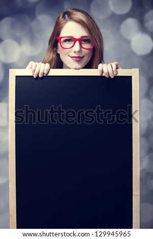 Redhead student with blackboard.
