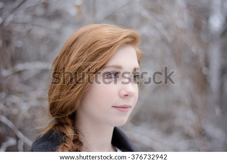 Redhead teenage girl profile picture with winter background