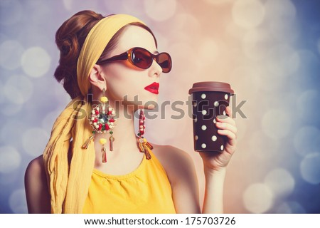 Redhead women with coffee. Photo with bokeh at background. - stock photo
